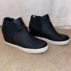 Black slip-on sneakers with a built in heel
